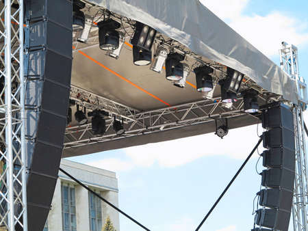 Photo for Structures of stage electric illumination spotlights equipment and speakers - Royalty Free Image