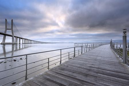 Photo pour Vasco da Gama Bridge landscape at sunrise. One of the longest bridges in the world. Lisbon is an amazing tourist destination because its light, its monuments. Portugal landmark. - image libre de droit