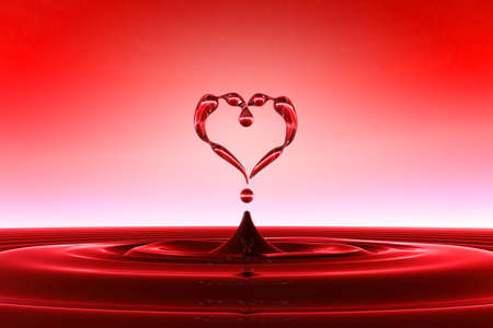 Foto de Heart shaped red water drops and splashing with waves. FAQ concept. Extralarge resolution - Imagen libre de derechos