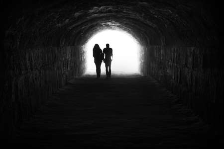 Photo for Couple and light in the end of the tunnel  Hope and freedom - Royalty Free Image