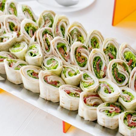 Foto de Plate of many mini bite size sandwich appetizers - Imagen libre de derechos