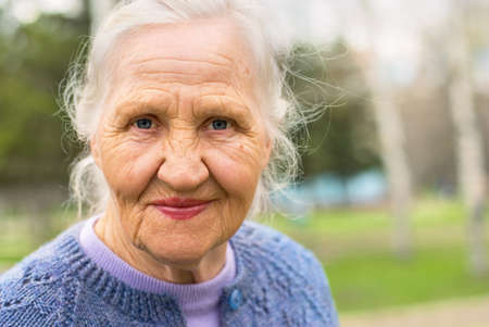 Photo for Portrait of a smiling elderly woman. A photo on the nature background - Royalty Free Image