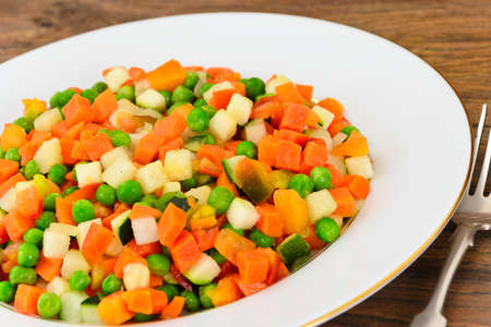 Juicy Vegetable Stew. Paprika, Peas and Carrots. Diet Food. Studio Photo