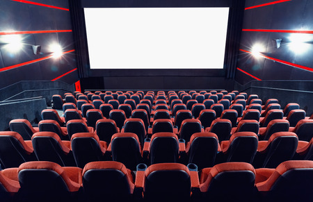 Photo for Empty cinema auditorium with screen and seats - Royalty Free Image