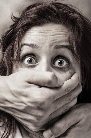 Foto de Fear of woman victim of domestic violence and abuse - Imagen libre de derechos
