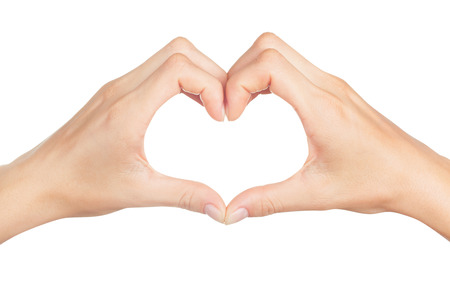 Photo pour Female hands in the form of heart isolated on white background - image libre de droit