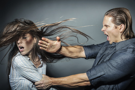 Photo pour Woman victim of domestic violence and abuse. The quarrel in the family. A man beats a young woman - image libre de droit