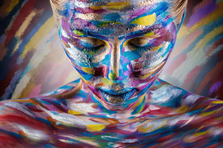 Photo for Young woman with colorful makeup and body art on a colorful background - Royalty Free Image