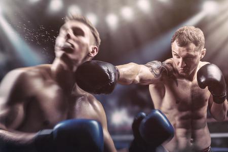 Foto de Two professional boxers fighting in the ring - Imagen libre de derechos