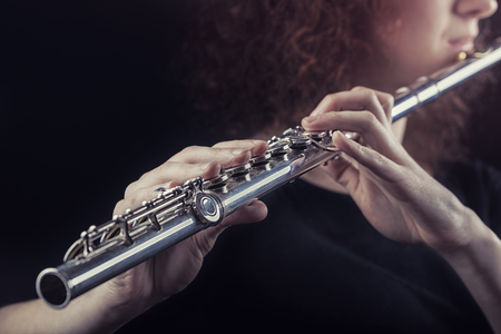 Photo for Close-up of a woman playing the flute. Musical concept - Royalty Free Image