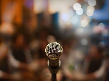 Photo pour Close up of microphone in concert hall or conference room - image libre de droit