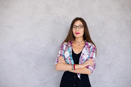 Photo for Smiling woman wearing glasses studio shot - Royalty Free Image