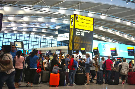 Photo for Travellers queuing at the airport - Royalty Free Image