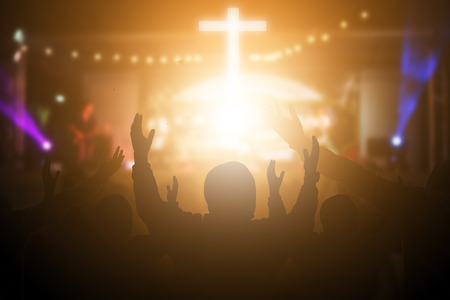 Photo pour Christians raising their hands in praise and worship at a night music concert. Eucharist Therapy Bless God Helping Repent Catholic Easter Lent Mind Pray. Christian concept background. - image libre de droit