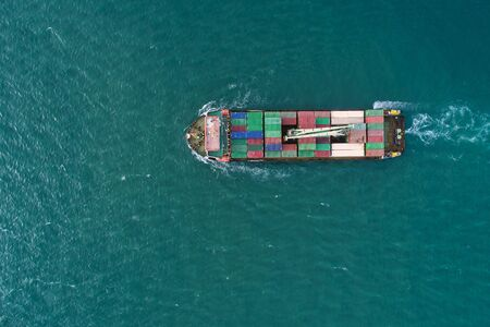 Foto de Aerial view container ship to sea port loading container for import export or transportation. shipping business logistic. Trade Port and Shipping cargo to harbor, International transportation. - Imagen libre de derechos