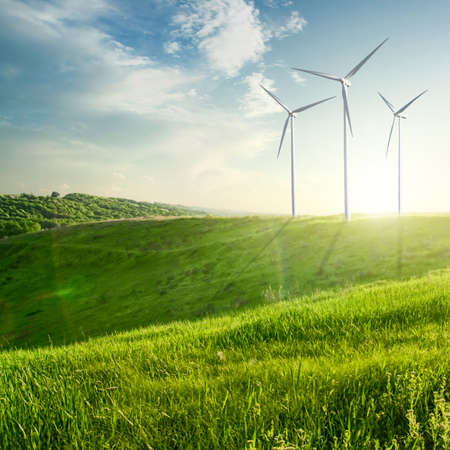 Photo for Wind generators turbines on sunset summer landscape - Royalty Free Image