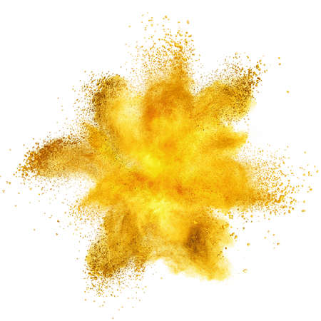 Foto de Yellow powder explosion isolated on white background - Imagen libre de derechos