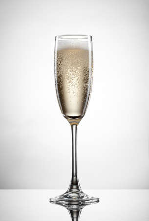 Photo for Sparkling champagne in glass isolated on white background - Royalty Free Image