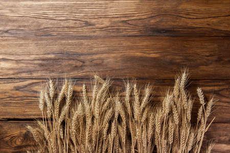 Foto de wheat on wooden background. top view - Imagen libre de derechos
