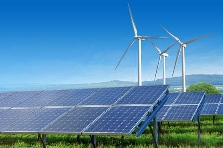 Photo pour solar panels and wind turbines under blue sky - image libre de droit