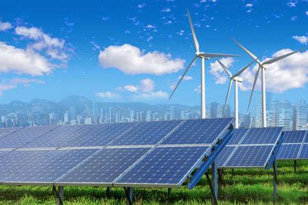 Photo pour Solar panels and wind turbines with city - image libre de droit