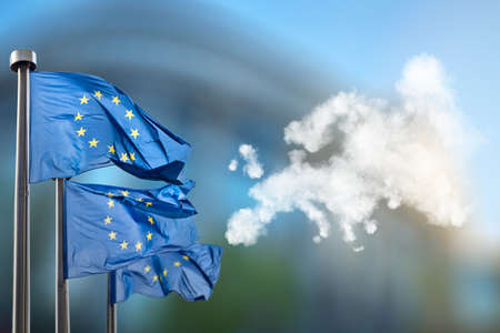 Foto de European union flags and map of Europe made of clouds - Imagen libre de derechos