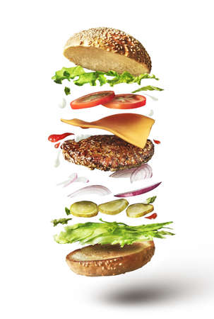 Photo pour Delicious hamburger with flying ingredients on white background - image libre de droit