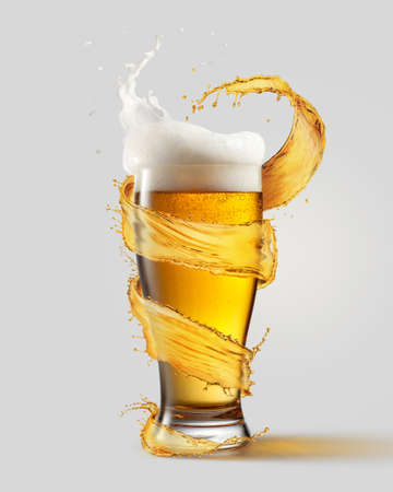 Foto de A cold glass of beer and a splash around it isolated on a gray background - Imagen libre de derechos