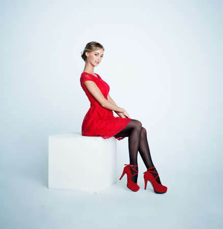 Photo pour Perfect Young Woman in Red Dress on White Background - image libre de droit
