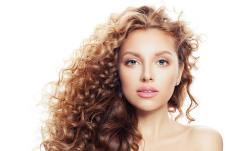 Foto de Young woman with clear skin and long curly hairstyle isolated on white - Imagen libre de derechos