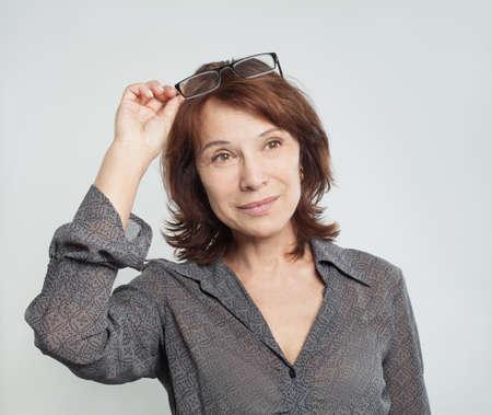 Photo pour Cute mature business woman with glasses, portrait - image libre de droit