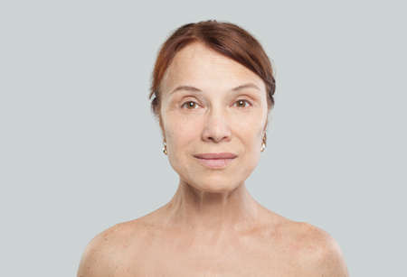 Foto de Mature female face on white - Imagen libre de derechos