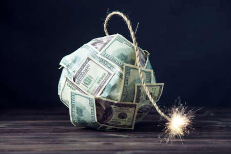 Photo for Big bomb of money hundred dollar bills with a burning wick. Little time before the explosion. The concept of financial crisis - Royalty Free Image