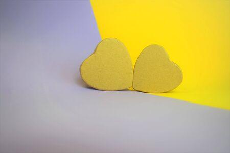 Foto de Cardboard hearts in bicolor background, holiday in valentine - Imagen libre de derechos