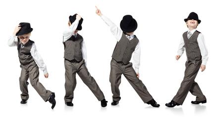 Foto de Little boy, who is looked as businessman, is dancing on white background - Imagen libre de derechos