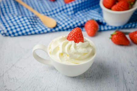 Photo for Dessert strawberries with whipped cream in a cup - Royalty Free Image