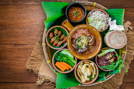Photo for Tradition Northern Thai food. Thai cuisine chili sauce, Thai sausages , deep fried pork skin, Steamed whole grain traditional. Thai food concept - Royalty Free Image
