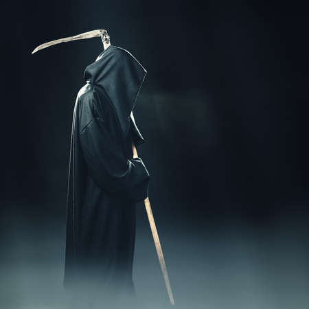 Photo for death with scythe standing in the fog at night - Royalty Free Image