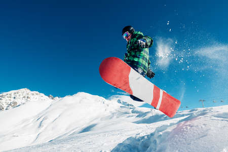 Foto de snowboarder is jumping with snowboard from snowhill very high - Imagen libre de derechos