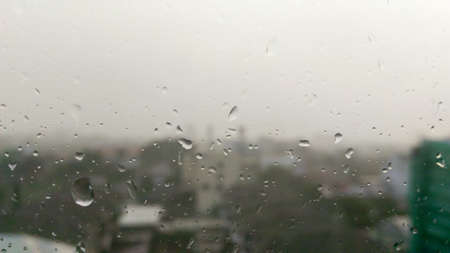 selective focus , Drops of rain on the window with city view  on background