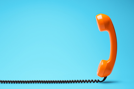 Photo for Telephone in retro style on blue background. - Royalty Free Image