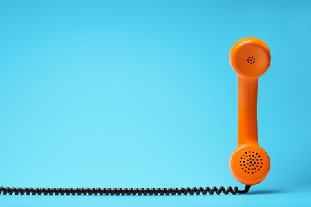 Photo pour Telephone in retro style on blue background. - image libre de droit