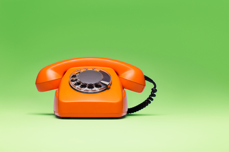 Photo for Telephone in retro style on green background. - Royalty Free Image