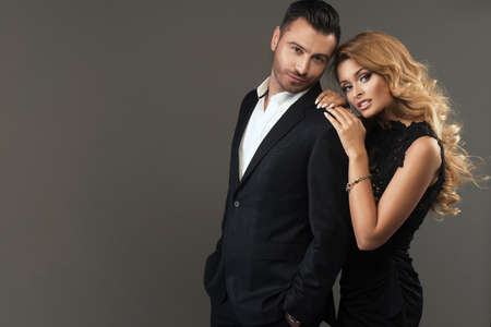 Photo pour portrait of a young fashion couple looking into the camera - image libre de droit