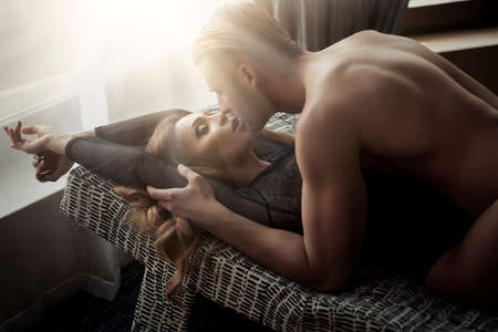 Photo for Sexy young couple kissing and playing in bed. - Royalty Free Image