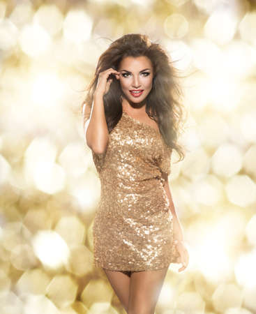 Photo for Beauty woman in gold dress - Royalty Free Image