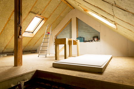 Foto de house attic under construction mansard wall insulation with rock wool - Imagen libre de derechos