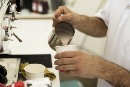 Foto de Barista preparing a cup of coffee - Imagen libre de derechos