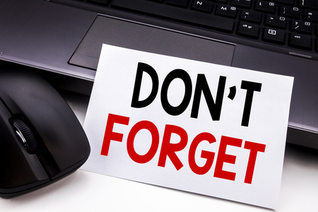 Foto de Conceptual hand writing text caption inspiration showing Do Not Forget. Business concept for Don t memory Remider written on sticky note paper on black keyboard background. - Imagen libre de derechos