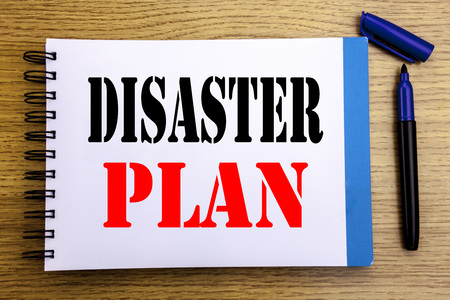 Foto de Handwriting Announcement text showing Disaster Plan. Business concept for Emergency Recovery Written on notepad paper background with space office view with pencil marker - Imagen libre de derechos